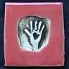 red hand tile